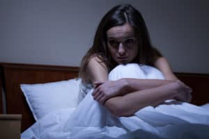 what is adrenal health - woman having sleepless night in bed