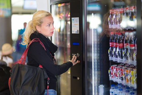 what is adrenal health - lady at vending machine