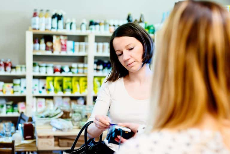 why are healthy foods expensive - woman paying with credit card