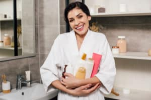 body toxicity symptoms - woman with personal care products