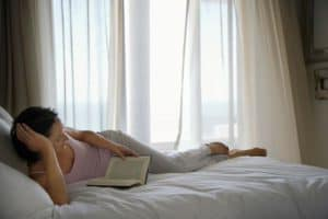 book stand for reading - woman reading in bed