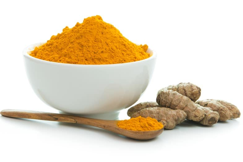 reducing inflammation body - turmeric root and powder