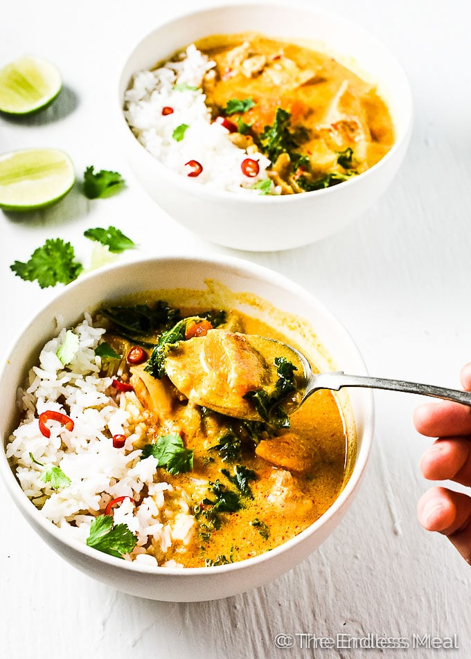 thai chicken curry in white bowls
