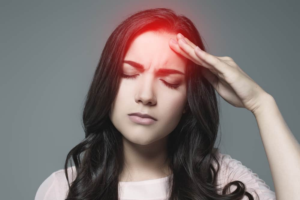fibromyalgia fatigue treatment - woman with headache